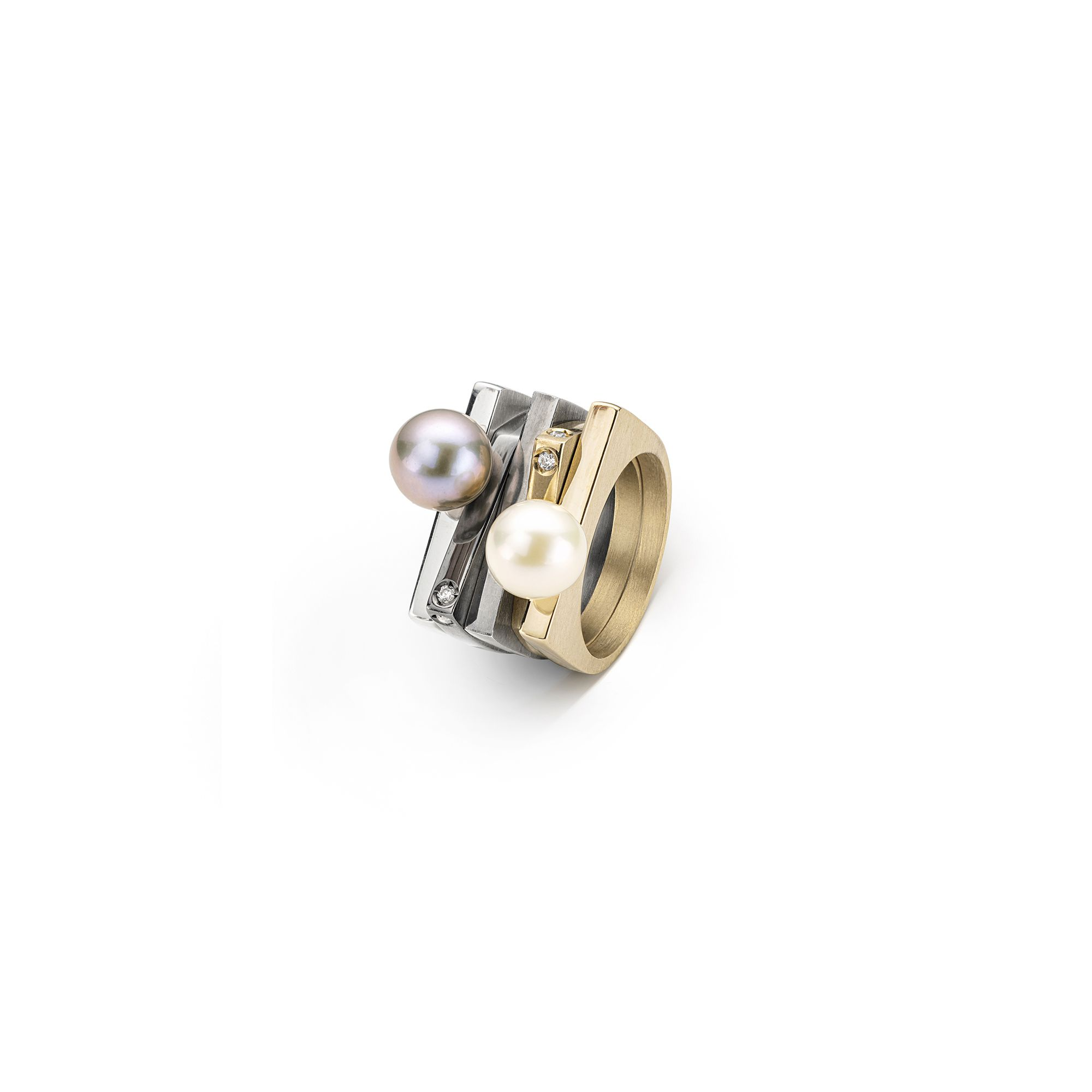 Stackable 'Congiunzioni' rings with pearls Silver and bronze rings with pearls and stones