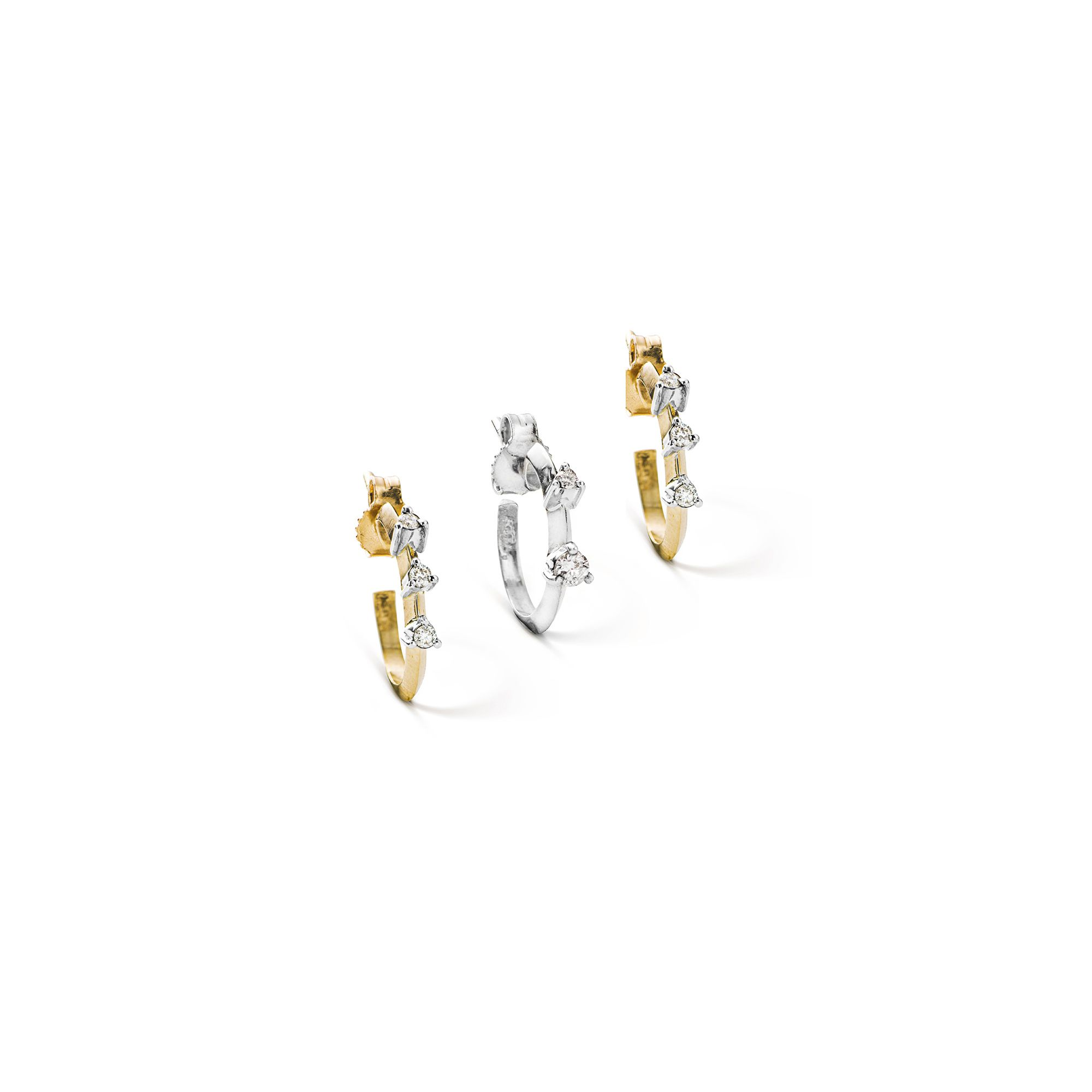 Set of three bicolor gold 'Balance' hoop earrings three small hoop earrings in yellow and white gold and diamonds